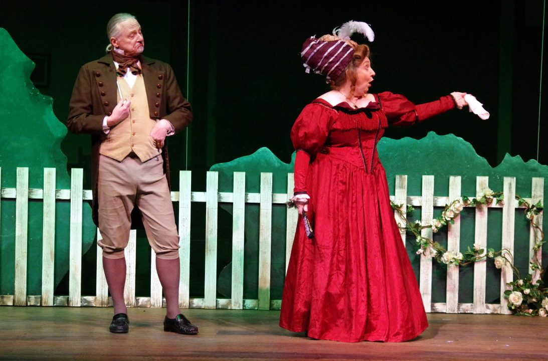 She Stoops tp Conquer Fence Scene
